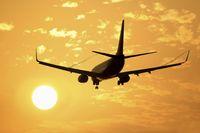 Airliner landing sunset